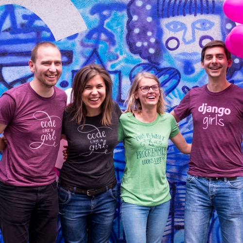 A group of people wearing Django Girls t-shirts.